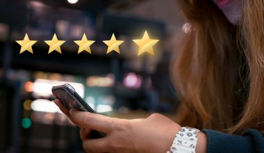 woman-submitting-5-star-local-review