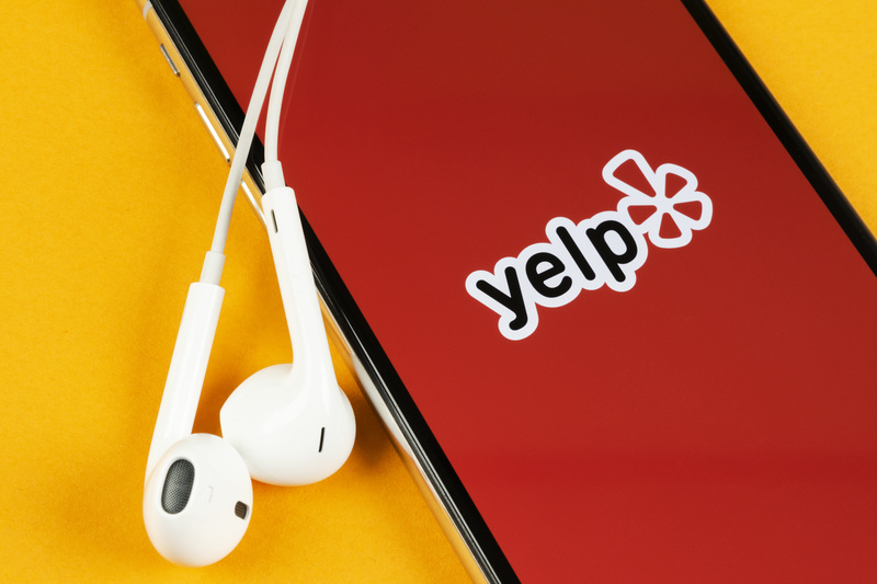 An image of Yelp's app on a mobile phone