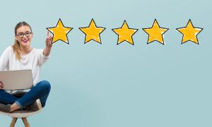 Five star rating with young woman using her laptop